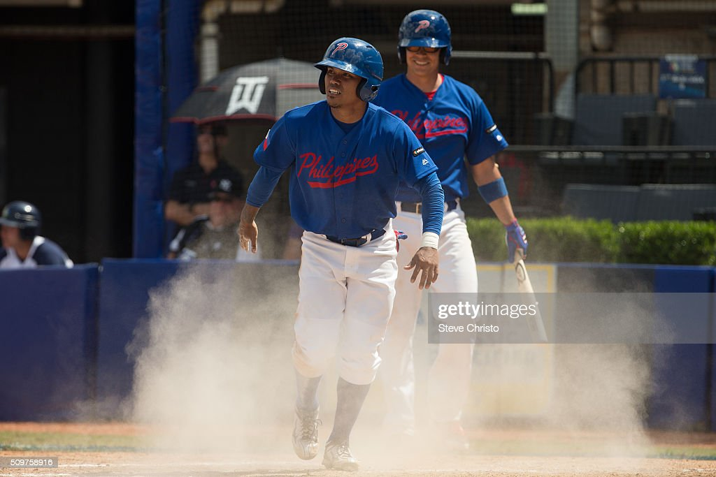 Jonash Ponce of team Philippines scores a run during Game 3 of the World Baseball Classic Qualifier against Team New Zealand at Blacktown International Sportspark on Friday, February 12, 2016 in Sydney, Australia.