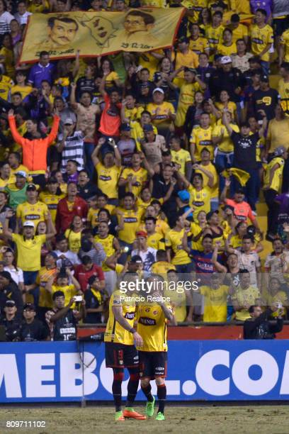 Jonatan Alvez of Barcelona celebrates with teammate Damian Diaz after scoring the opening goal during a first leg match between Barcelona SC and...