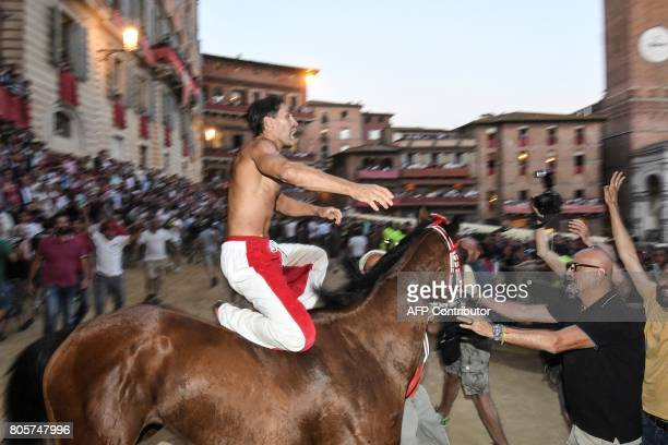 Jonatan Bartoletti known as Scompiglio rides his horse Sarbana as he competes in the historical Italian horse race 'Palio di Siena' on July 2 2017 in...
