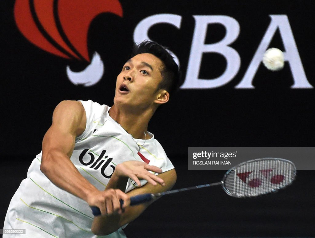 Jonatan Christie of Indonesia plays a shot against Lee Dong Keun
