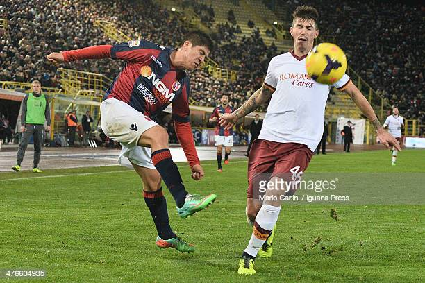 Jonatan Cristaldo of Bologna FC kicks the ball past Alessio Romagnoli of AS Roma during the Serie A match between Bologna FC and AS Roma at Stadio...