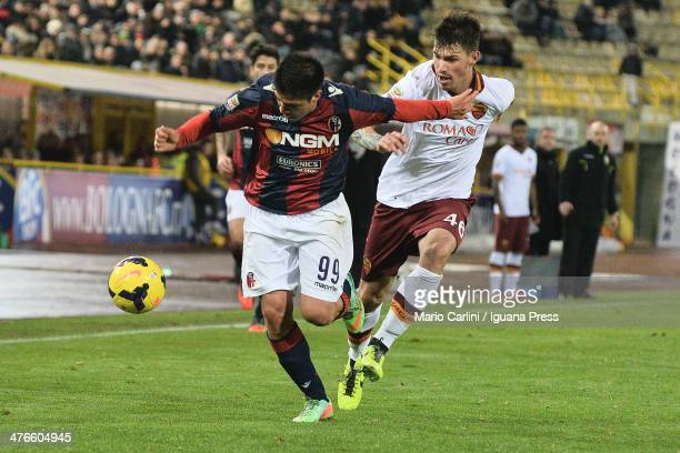 Jonatan Cristaldo of Bologna FC L competes the ball with Alessio Romagnoli of AS Roma during the Serie A match between Bologna FC and AS Roma at...
