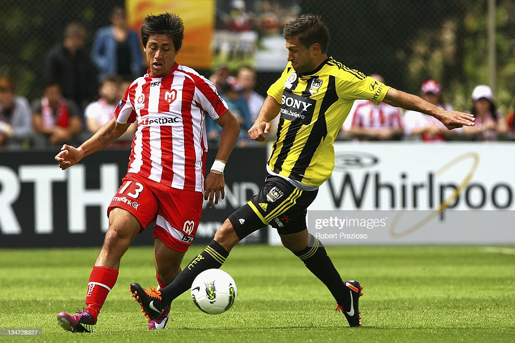 Jonatan Germano of the Heart and Vince Lia of the Phoenix contest the ball during the round nine A-League match between the Melbourne Heart and the Wellington Phoenix at Latrobe City Sports & Entertainment Complex on December 4, 2011 in Melbourne, Australia.