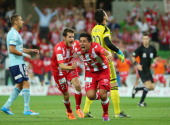 Jonatan Germano of the Heart celebrates after scoring a goal during the round 17 ALeague match between Melbourne Heart and Sydney FC at AAMI Park on...