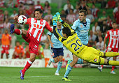 Jonatan Germano of the Heart competes for the ball with goalkeeper Vedran Janjetovic of Sydney FC before scoring a goal during the round 17 ALeague...
