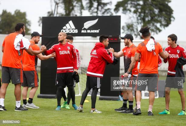 Jonatan Maidana and Gonzalo Martinez of River Plate greet All Blacks players during the New Zealand Rugby Championship Media Day ahead of the match...