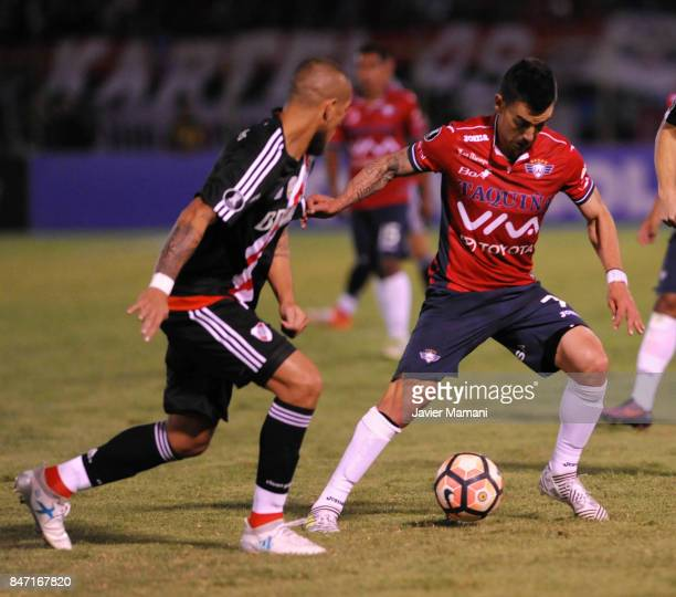 Jonatan Maidana of River Plate and Marcelo Bergese of Wilstermann compete for the ball during a first leg match between Wilstermann and River Plate...