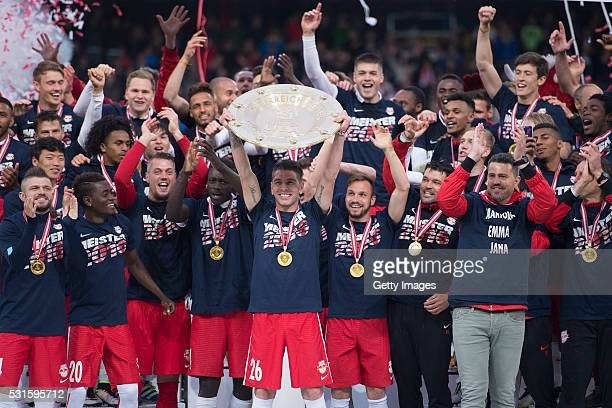 Jonatan Soriano celebrates with the trophy and his teammates Valon Berisha HeeChan Hwang David Atanga Alexander Walke Dayot Upamecano Andreas Ulmer...