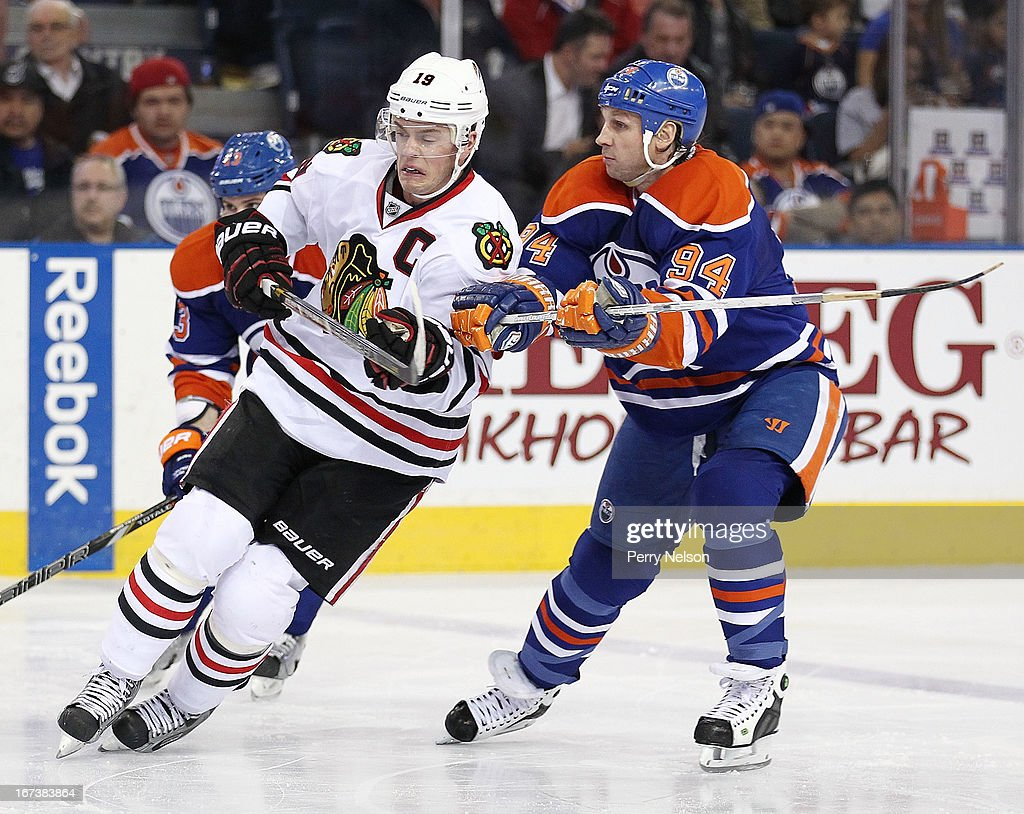 Jonatan Toews #19 of the Chicago Blackhawks battles with <a gi-track='captionPersonalityLinkClicked' href=/galleries/search?phrase=Ryan+Smyth+-+Ice+Hockey+Player&family=editorial&specificpeople=202567 ng-click='$event.stopPropagation()'>Ryan Smyth</a> #94 of the Edmonton Oilers at Rexall Place on April 24, 2013 in Edmonton, Alberta, Canada.