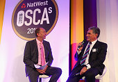 Jonathan Agnew speaks to actor Jim Carter during the NatWest Outstanding Service to Cricket Awards at Lord's Cricket Ground on October 12 2015 in...