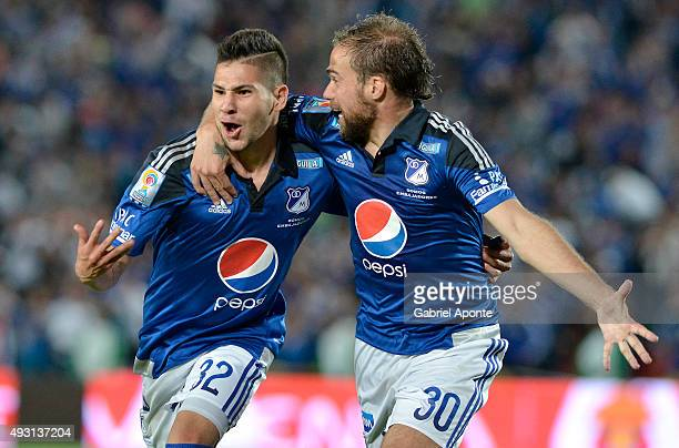 Jonathan Agudelo of Millonarios celebrates with Federico Insua after scoring the second goal of his team during a match between Millonarios and...