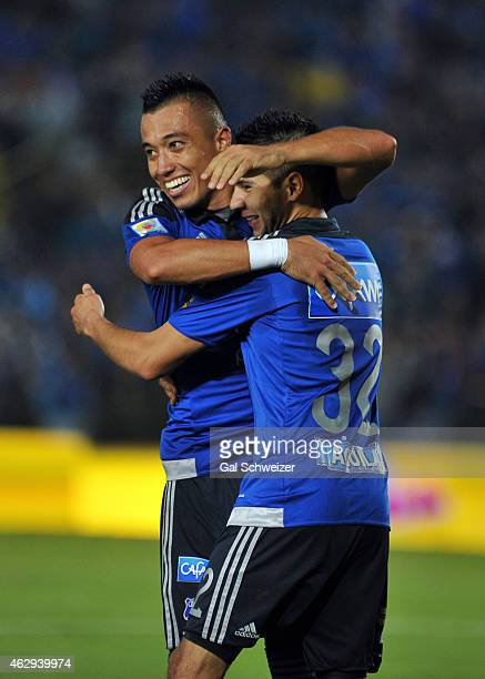 Jonathan Agudelo of Millonarios celebrates with teammate Fernando Uribe after scoring the second goal of his team during a match between Millonarios...