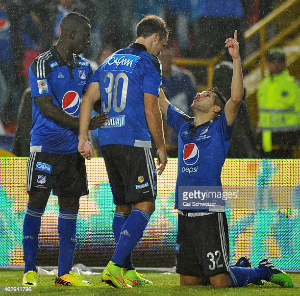 Jonathan Agudelo of Millonarios celebrates with teammates Federico Insua and Deiver Machado after scoring his first goal during a match between...
