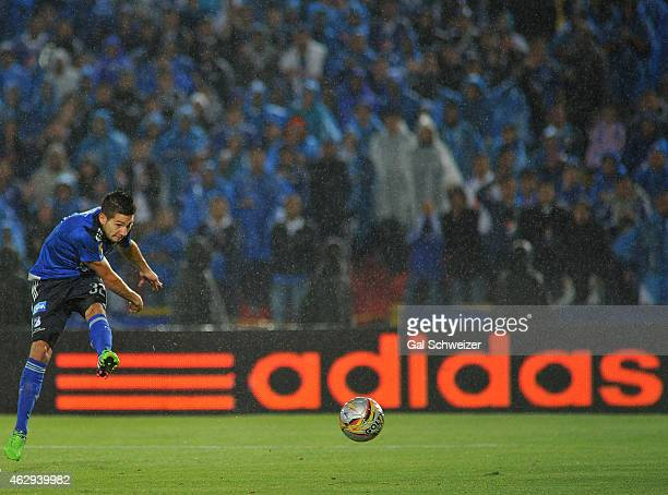 Jonathan Agudelo of Millonarios kicks tha ball to score his first goal during a match between Millonarios and Patriotas FC as part of second round of...
