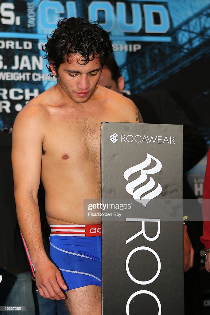 Jonathan Alcantara stands on the scale during the weigh in on March 8, 2013 at the Barclays Center in the Brooklyn borough of New York City.