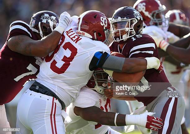 Jonathan Allen of the Alabama Crimson Tide tackles Dak Prescott of the Mississippi State Bulldogs at Davis Wade Stadium on November 14 2015 in...
