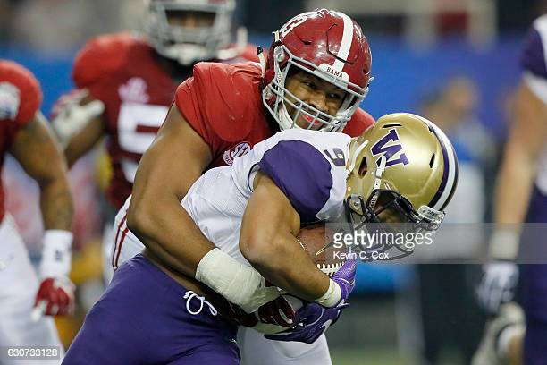 Jonathan Allen of the Alabama Crimson Tide tackles Myles Gaskin of the Washington Huskies during the 2016 ChickfilA Peach Bowl at the Georgia Dome on...