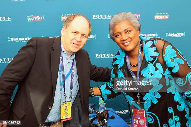Jonathan Alter poses for a photo with Donna Brazile on SiriusXM on July 27 2016 in Philadelphia Pennsylvania
