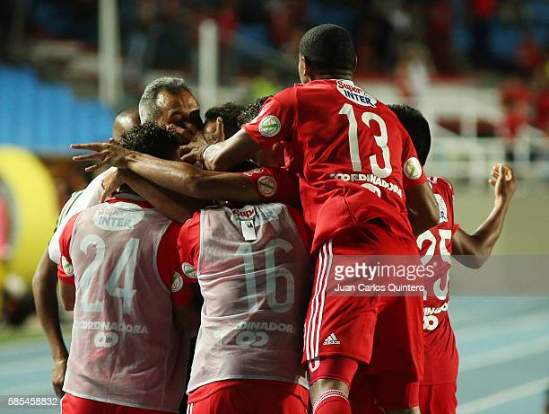 Jonathan Alvarez of America celebrates with teammates after scoring the first goal of his team during a match between America de Cali and Leones as...
