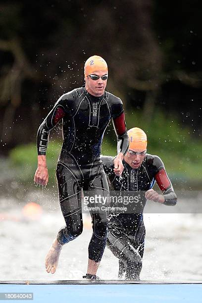 Jonathan and Alistair Brownlee of Great Britain complete the first swim lap during the Elite Men's PruHealth World Triathlon Grand Final London and...