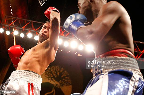 Jonathan Arellano throws a left at Michael Oliver during the fourth round during their bout in the season two finale of NUVOtv's Knockout at Foxwoods...