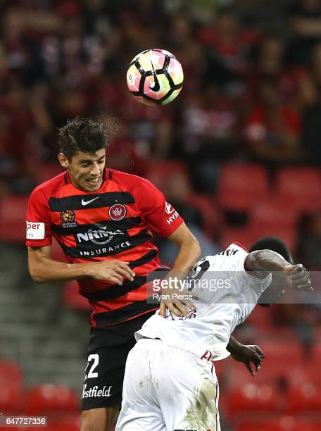 Jonathan Aspropotamis of the Wanderers competes for the ball against Baba Diawara of Adelaide United during the round 22 ALeague match between the...