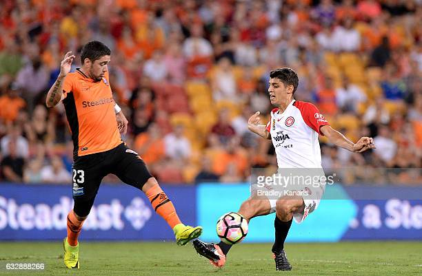 Jonathan Aspropotamitis of the Wanderers is challenged by Dimitri Petratos of the Roar during the round 17 ALeague match between the Brisbane Roar...