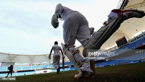 Jonathan Bairstow and Joe Root of England run out ahead of day five of the 2nd test match between Pakistan and England at Dubai Cricket Stadium on...