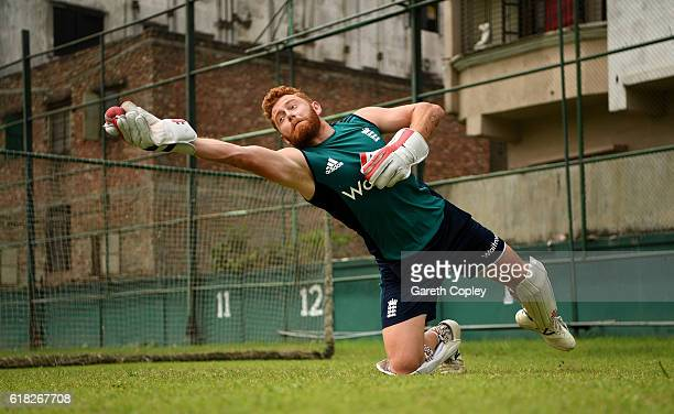 Jonathan Bairstow of England takes part in a wicketkeeping drill during a nets session at ShereBangla National Cricket Stadium on October 26 2016 in...