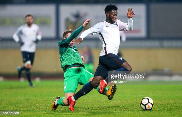 Jonathan Bamba of France faulted by Gal Primc of Slovenia during the Under 21s Euro 2019 qualifying match between Slovenia U21 and France U21 on...