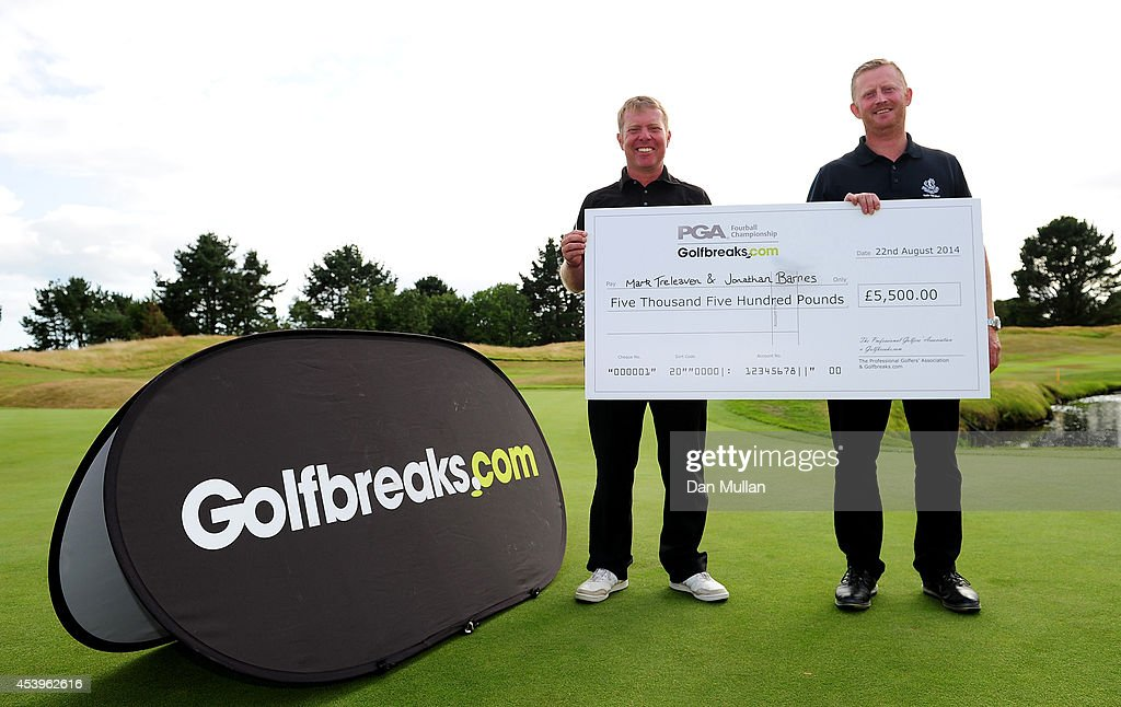 Jonathan Barnes (L) of Lee-on-The-Solent Golf Club and Mark Treleaven of Hayling Golf Club celebrate with their cheque after being crowned champions during day three of the Golfbreaks.com PGA Fourball Championship at St. Mellion International Resort on August 22, 2014 in Saltash, England.