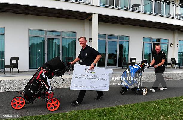 Jonathan Barnes of LeeonTheSolent Golf Club and Mark Treleaven of Hayling Golf Club leave the course with their cheque after being crowned champions...