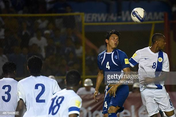 Jonathan Barrios of the National football Team of El Salvador fights for the ball against Dustley Mulder of the National selection of Curazao at the...