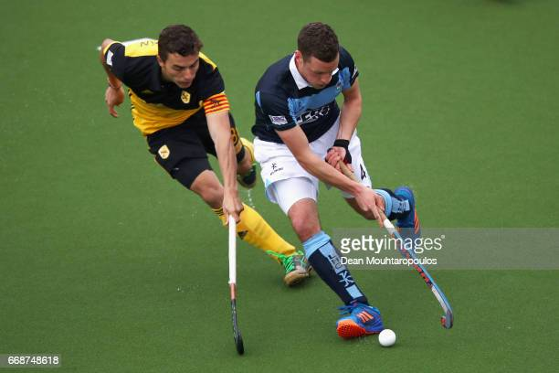 Jonathan Bell of Lisnagarvey battles for the ball with Albert Beltran of Atletic Terrassa HC during the Euro Hockey League KO16 match between Atletic...