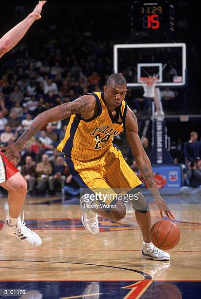Jonathan Bender of the Indiana Pacers drives to the basket during the game against the Golden State Warriors at The Arena in Oakland on March 2 2004...
