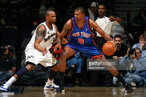 Jonathan Bender of the New York Knicks looks to make a move against Caron Butler of the Washington Wizards during the game at the Verizon Center on...
