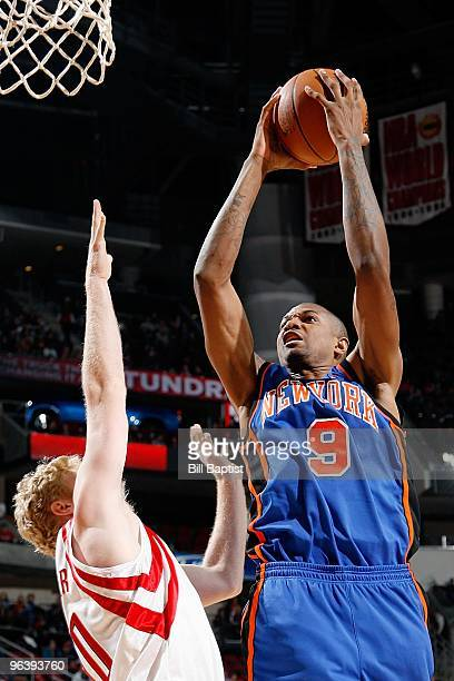 Jonathan Bender of the New York Knicks puts up a shot against Chase Budinger of the Houston Rockets during the game on January 9 2010 at the Toyota...