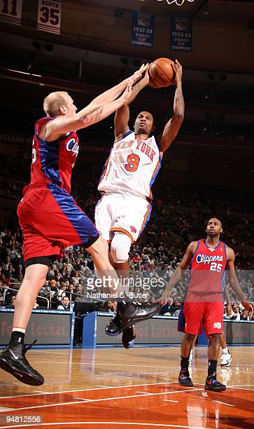 Jonathan Bender of the New York Knicks shoots against Chris Kaman of the Los Angeles Clippers on December 18 2009 at Madison Square Garden in New...