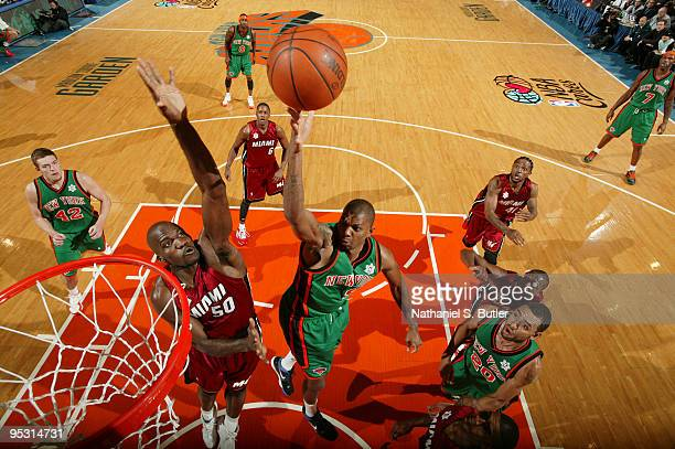 Jonathan Bender of the New York Knicks shoots against Joel Anthony of the Miami Heat on December 25 2009 at Madison Square Garden in New York City...