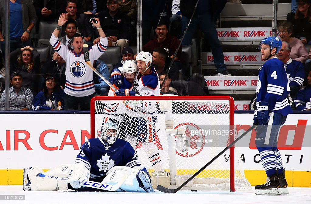 <a gi-track='captionPersonalityLinkClicked' href=/galleries/search?phrase=Jonathan+Bernier&family=editorial&specificpeople=540491 ng-click='$event.stopPropagation()'>Jonathan Bernier</a> #45 and <a gi-track='captionPersonalityLinkClicked' href=/galleries/search?phrase=Cody+Franson&family=editorial&specificpeople=2125769 ng-click='$event.stopPropagation()'>Cody Franson</a> #4 of the Toronto Maple Leafs regroup after <a gi-track='captionPersonalityLinkClicked' href=/galleries/search?phrase=Jordan+Eberle&family=editorial&specificpeople=4898161 ng-click='$event.stopPropagation()'>Jordan Eberle</a> #14 and <a gi-track='captionPersonalityLinkClicked' href=/galleries/search?phrase=Ryan+Smyth+-+Ice+Hockey+Player&family=editorial&specificpeople=202567 ng-click='$event.stopPropagation()'>Ryan Smyth</a> #94 of the Edmonton Oilers celebrate <a gi-track='captionPersonalityLinkClicked' href=/galleries/search?phrase=Ryan+Smyth+-+Ice+Hockey+Player&family=editorial&specificpeople=202567 ng-click='$event.stopPropagation()'>Ryan Smyth</a>'s goal during NHL action at the Air Canada Centre October 12, 2013 in Toronto, Ontario, Canada.