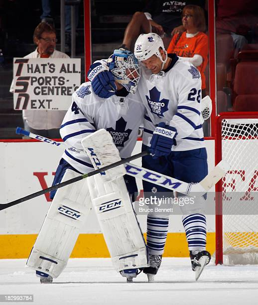 Jonathan Bernier and Colton Orr of the Toronto Maple Leafs embrace after defeating the Philadelphia Flyers at the Wells Fargo Center on October 2...