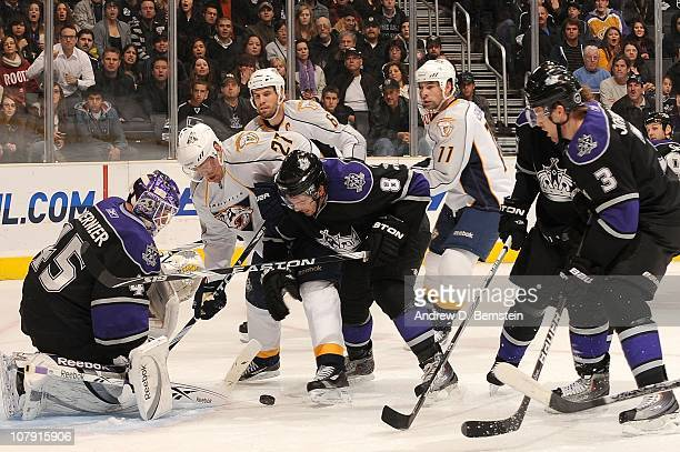 Jonathan Bernier and Drew Doughty of the Los Angeles Kings defend the puck outside the crease against Patric Hornqvist and David Legwand of the...