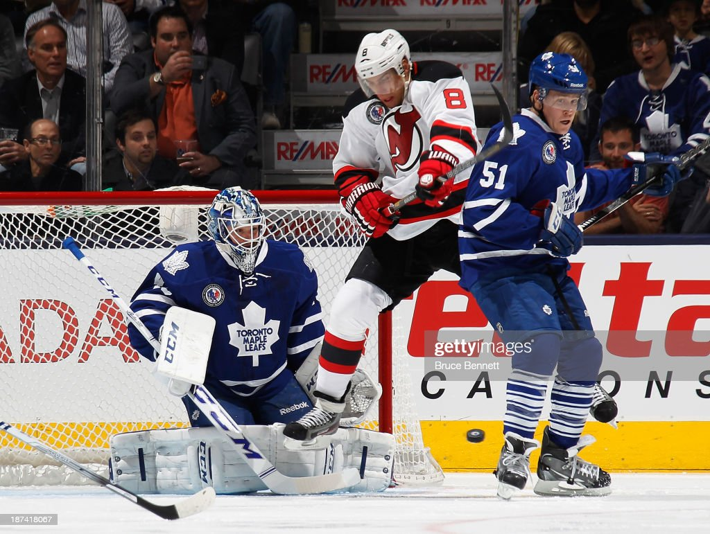 Jonathan Bernier #45 and Jake Gardiner #51 of the Toronto Maple Leafs defend against Dainius Zubrus #8 of the New Jersey Devils during the first period at the Air Canada Centre on November 8, 2013 in Toronto, Canada.