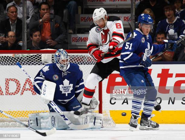 Jonathan Bernier and Jake Gardiner of the Toronto Maple Leafs defend against Dainius Zubrus of the New Jersey Devils during the first period at the...