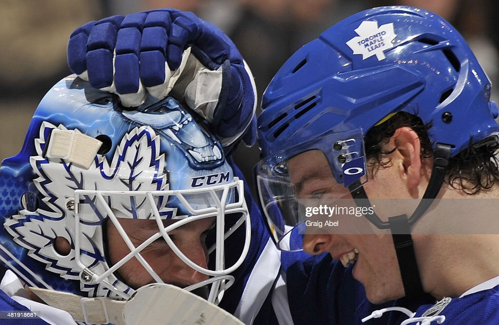 <a gi-track='captionPersonalityLinkClicked' href=/galleries/search?phrase=Jonathan+Bernier&family=editorial&specificpeople=540491 ng-click='$event.stopPropagation()'>Jonathan Bernier</a> #45 and <a gi-track='captionPersonalityLinkClicked' href=/galleries/search?phrase=Mason+Raymond&family=editorial&specificpeople=4521385 ng-click='$event.stopPropagation()'>Mason Raymond</a> #12 of the Toronto Maple Leafs celebrate the teams win over the Calgary Flames during NHL game action April 1, 2014 at the Air Canada Centre in Toronto, Ontario, Canada.