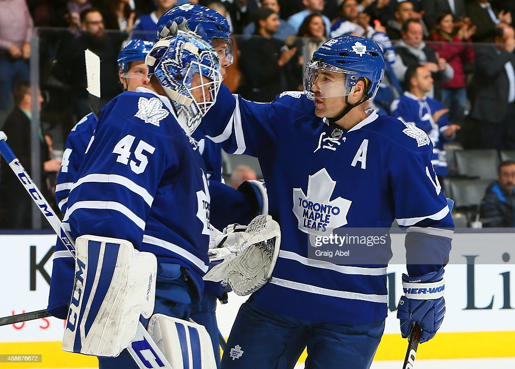 <a gi-track='captionPersonalityLinkClicked' href=/galleries/search?phrase=Jonathan+Bernier&family=editorial&specificpeople=540491 ng-click='$event.stopPropagation()'>Jonathan Bernier</a> #45 and <a gi-track='captionPersonalityLinkClicked' href=/galleries/search?phrase=Stephane+Robidas&family=editorial&specificpeople=206166 ng-click='$event.stopPropagation()'>Stephane Robidas</a> #12 of the Toronto Maple Leafs celebrate the win against the Boston Bruins during NHL game action November 12, 2014 at the Air Canada Centre in Toronto, Ontario, Canada.