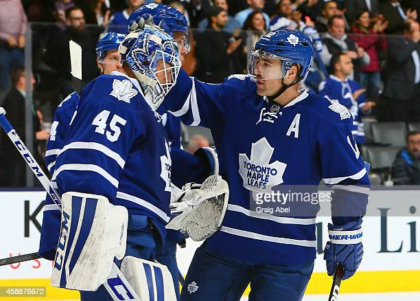 Jonathan Bernier and Stephane Robidas of the Toronto Maple Leafs celebrate the win against the Boston Bruins during NHL game action November 12 2014...