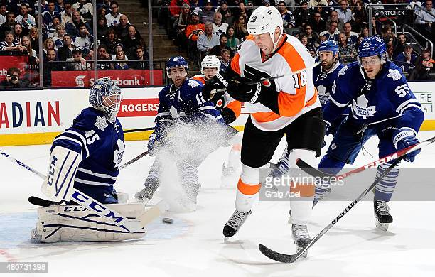 Jonathan Bernier blocks the shot from RJ Umberger of the Toronto Maple Leafs of the Philadelphia Flyers during NHL game action December 20 2014 at...