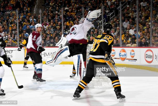 Jonathan Bernier of the Colorado Avalanche jumps in the air against Sidney Crosby of the Pittsburgh Penguins at PPG Paints Arena on December 11 2017...