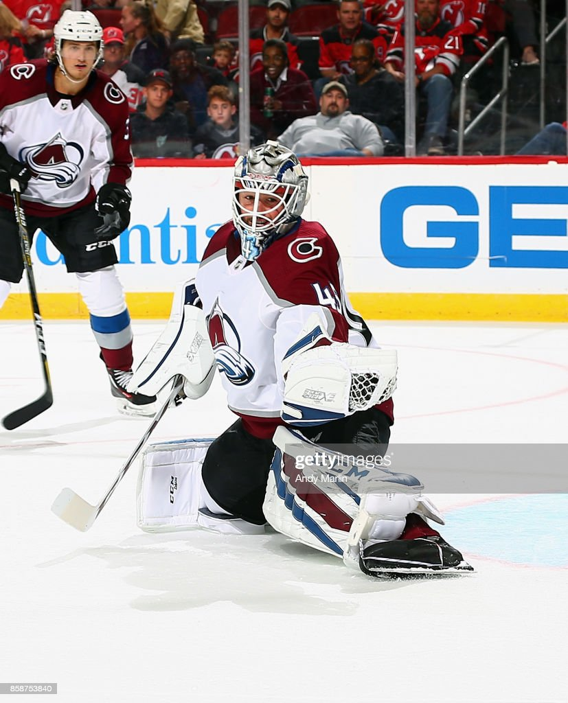 Jonathan Bernier #45 of the Colorado Avalanche makes a glove save against the New Jersey Devils during the Devils season opener at Prudential Center on October 7, 2017 in Newark, New Jersey.